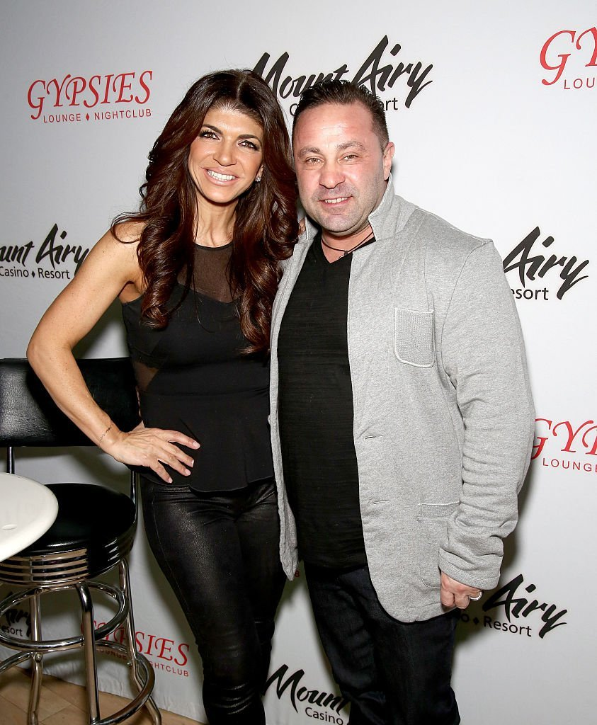 Teresa Giudice, (L) star of The Real Houswives of New Jersey, and Joe Giudice appears at Mount Airy Resort Casino for a book signing and meet and greet | Photo: Getty Images