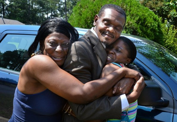 Henry McCollum hugging his cousin as he arrives in Fayetteville, N.C. on September 3, 2014.|  Photo: Getty Images