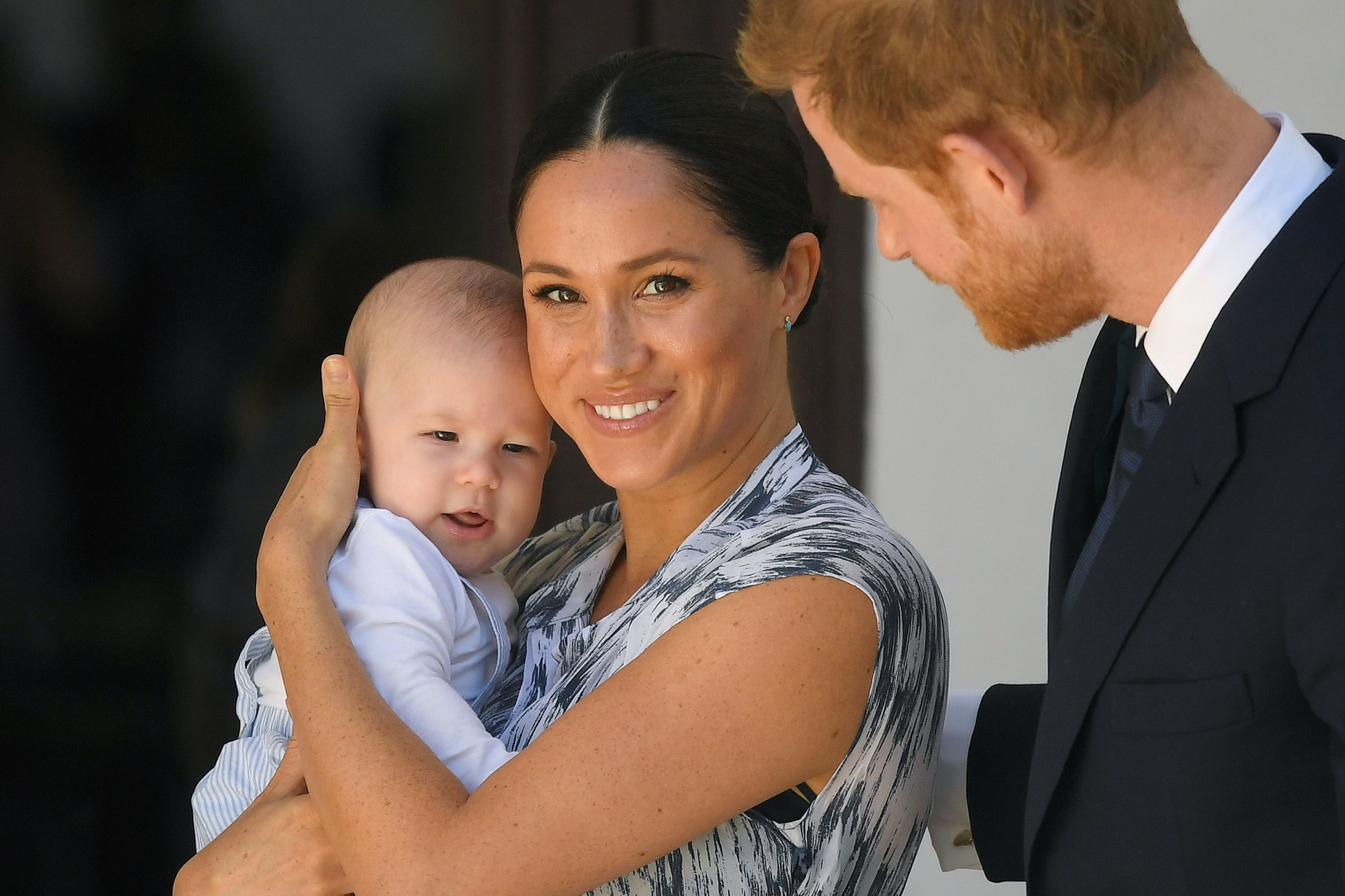 Archie Mountbatten-Windsor, Duchess Meghan, and Prince Harry at a meeting with Archbishop Desmond Tutu during their royal tour of South Africa on September 25, 2019, in Cape Town | Photo: Toby Melville - Pool/Getty Images