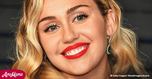 Miley Cyrus celebrates Mother's Day in a sports bra with mom as she spanks her on new photos