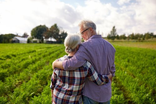 A retired couple looking over their farm. | Source: Shutterstock.