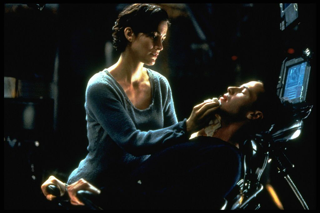 Carrie-Anne Moss and Keanu Reeves in The Matrix.   Source: Getty Images