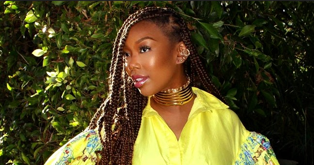 Brandy of 'Moesha' Fame Snatches Hearts in Yellow Puff-Sleeved Dress and Gold Choker in Gorgeous Pic