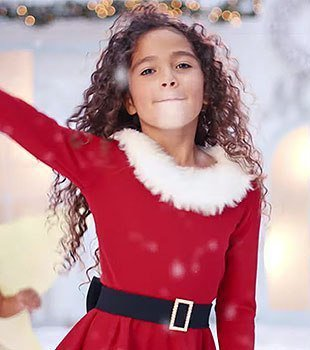 "Mariah Carey's daughter Monroe in the new video ""All I Want For Christmas Is You""/ Source: YouTube/ Mariah Carey"
