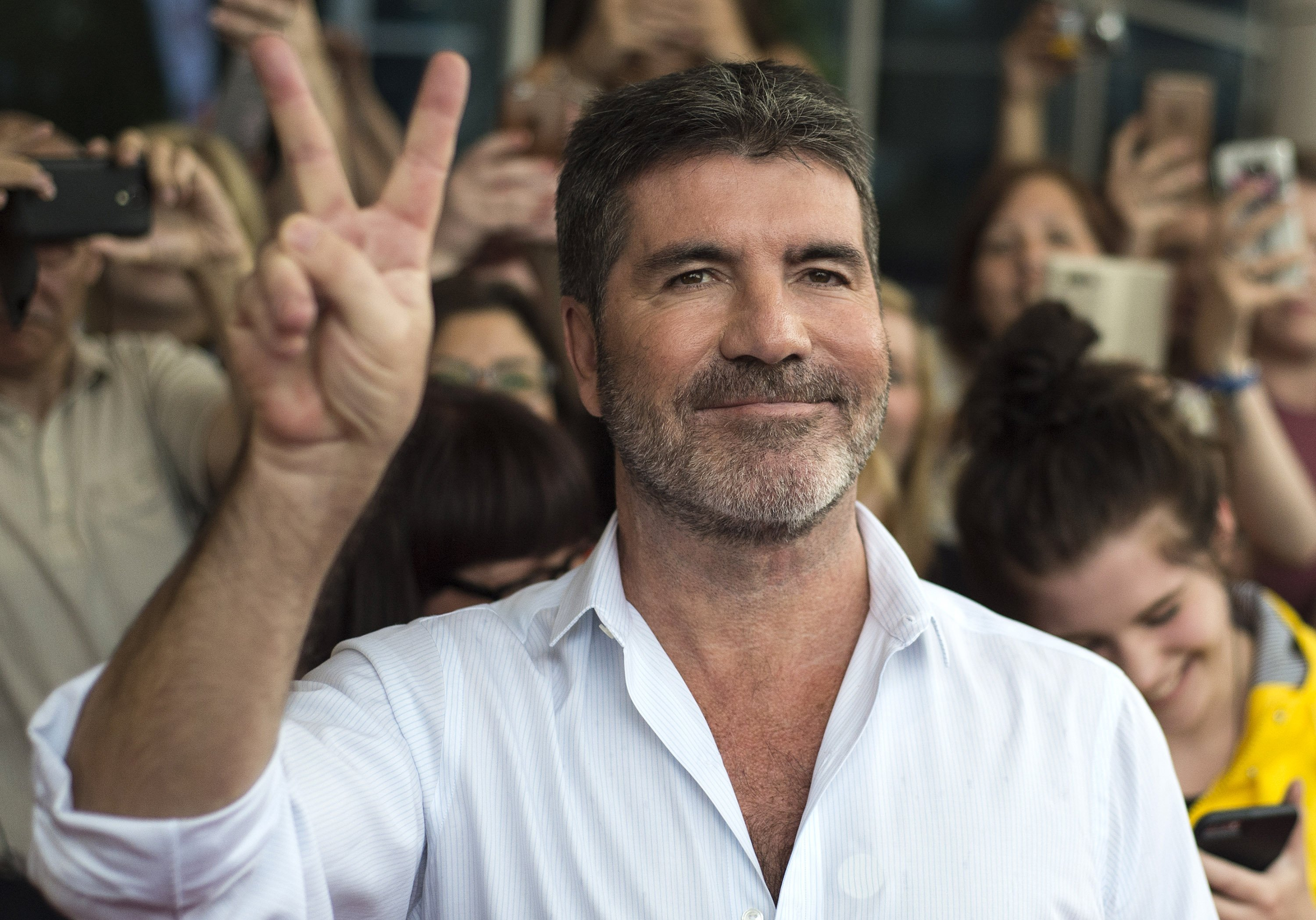 Simon Cowell arrives for X Factor auditions in Leicester, UK on June 10, 2016 | Photo: Getty Images