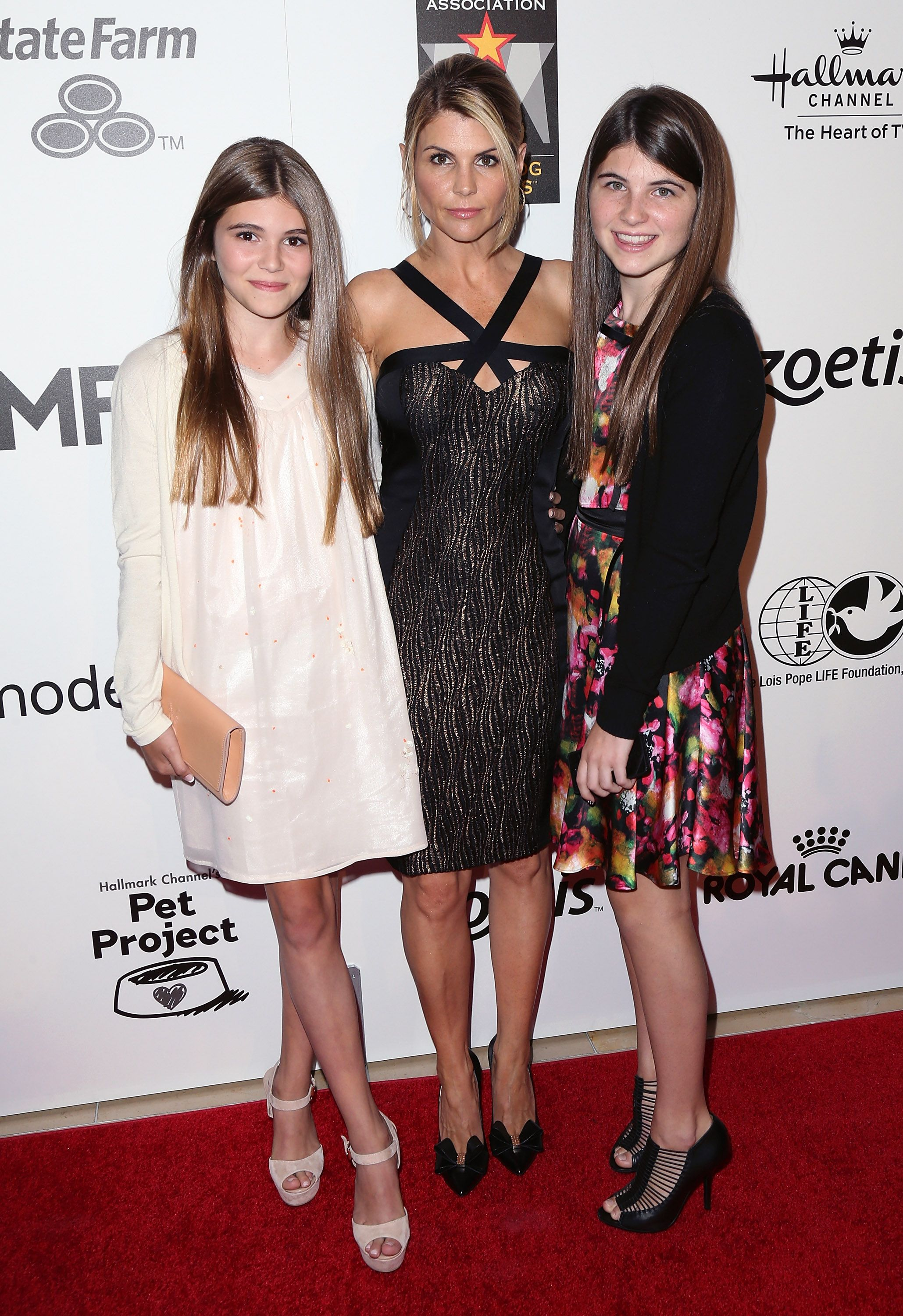 Olivia Giannulli, Lori Loughlin, and Isabella Giannulli during the 3rd Annual American Humane Association Hero Dog Awards on October 5, 2013, in Beverly Hills, California.   Source: Getty Images