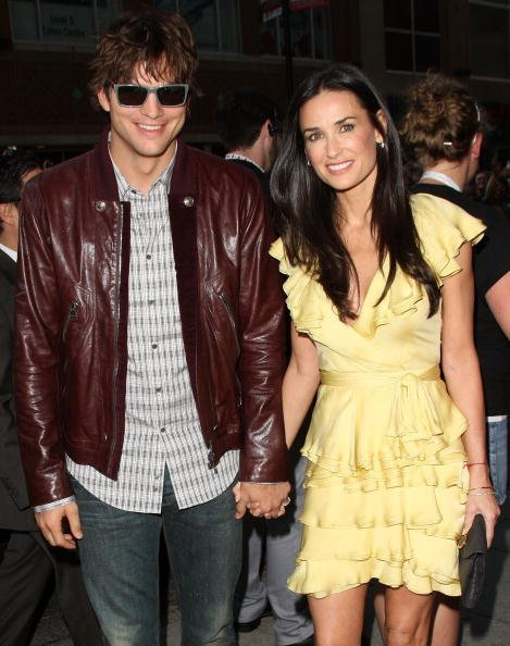 "Ashton Kutcher (L) and wife actress Demi Moore arrive at the ""The Joneses"" screening during the 2009 Toronto International Film Festival held at the Visa Screening Room at the Elgin Theatre on September 13, 2009, in Toronto, Canada. 