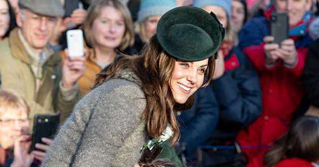 Kate Middleton Looks Festive in Chic Long Fur-Detailed Coat & a Green Hat at Christmas Outing