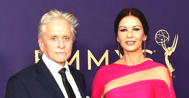 Catherine Zeta-Jones Looks Gorgeous in One-Shoulder Cape Dress in Recent Photo with Her Husband Michael Douglas