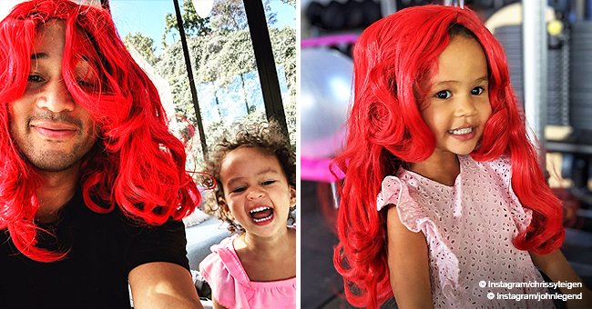 John Legend and daughter Luna take turns wearing a fiery red wig in adorable photos