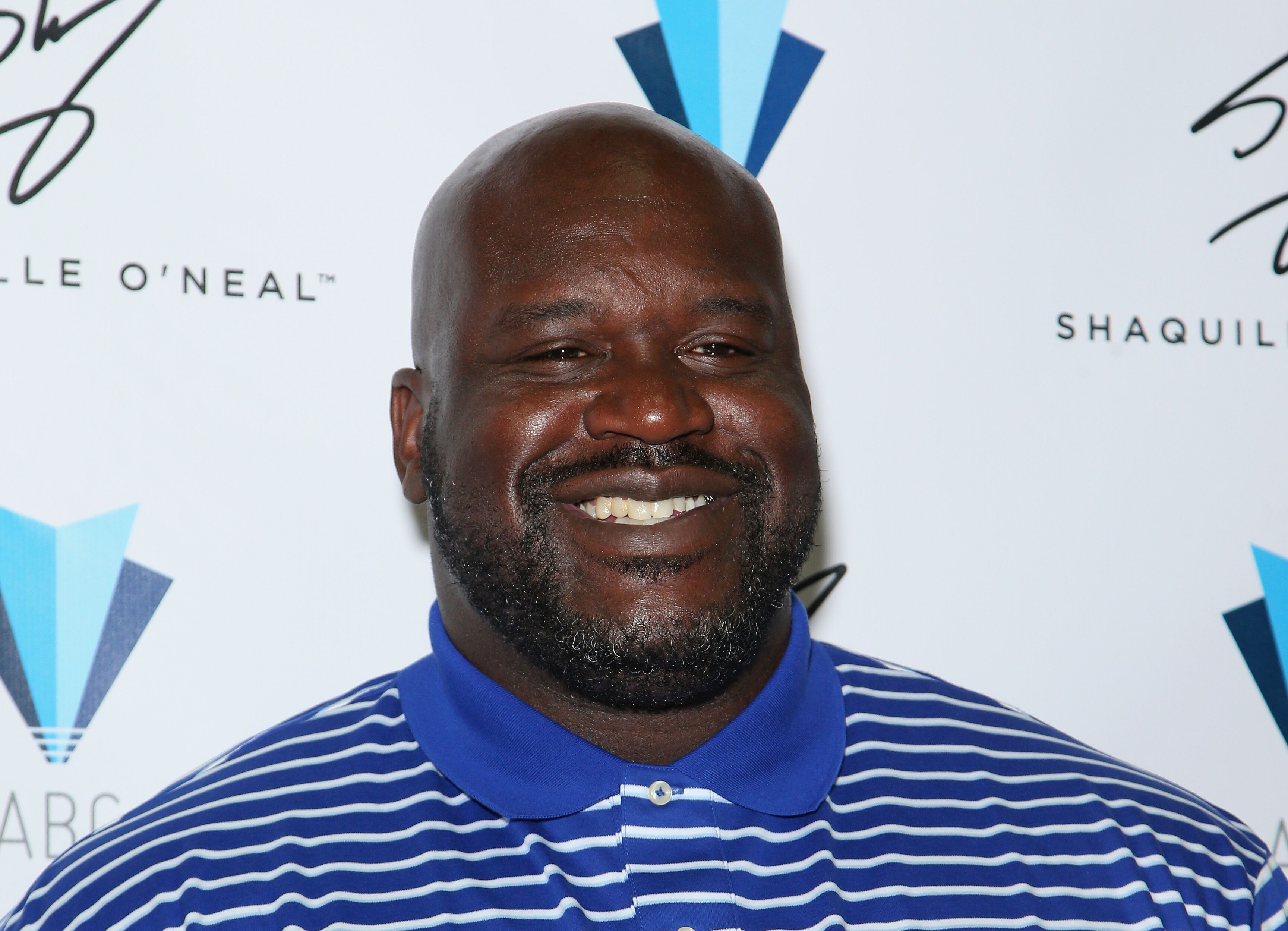 Shaquille O'Neal poses in the Authentic Brands Group booth during the Licensing Expo. | Source: Getty Images