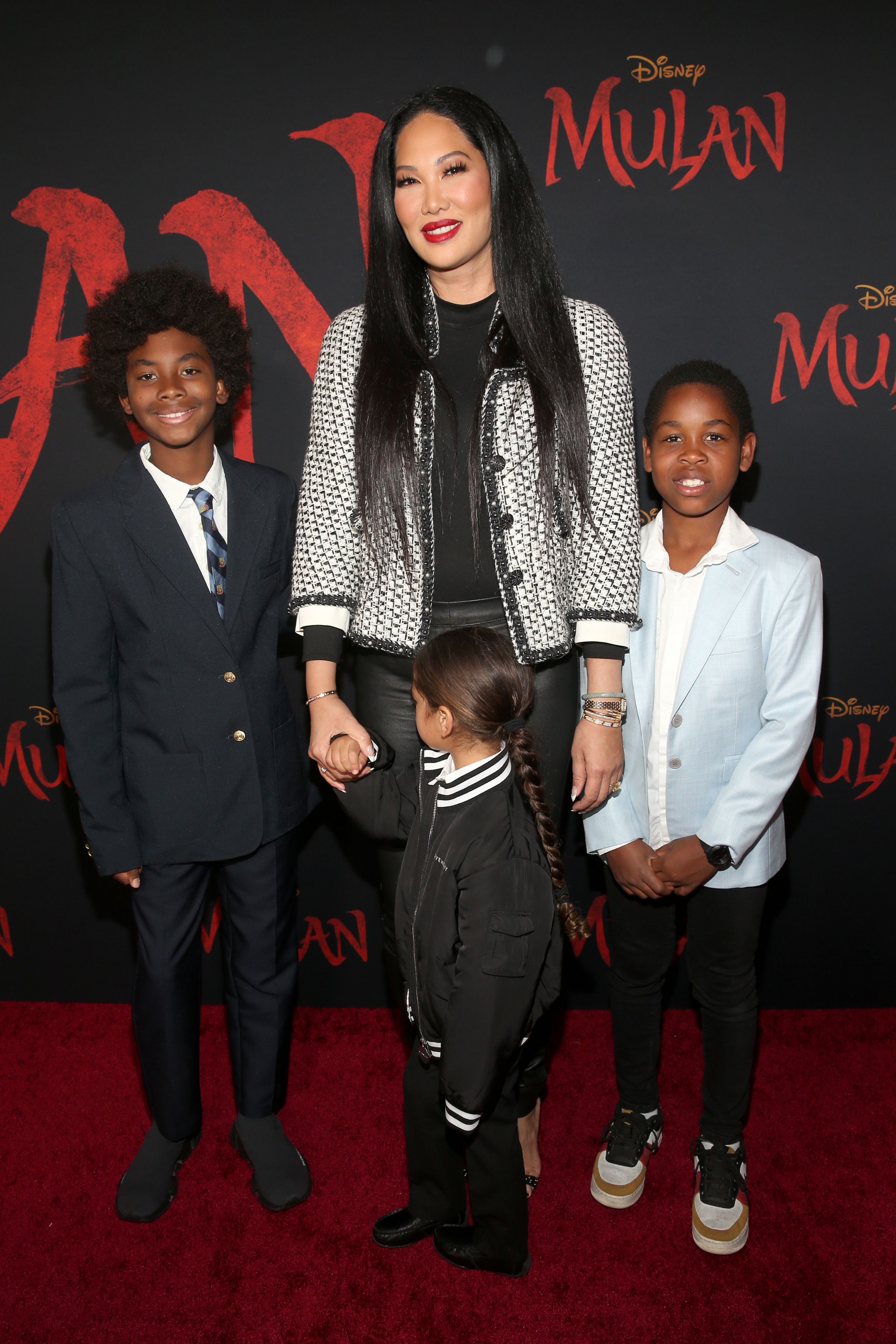 """Kimora Lee Simmons and sons attend the World Premiere of Disney's """"MULAN"""" at the Dolby Theatre on March 9, 2020 in Hollywood, California 