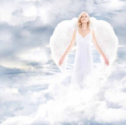 A beautiful angel on clouds | Photo: Getty Images