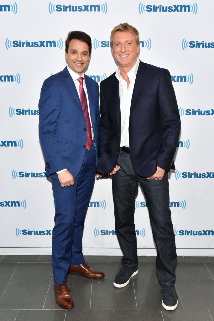 Ralph Macchio (L) and William Zabka visit SiriusXM Studios on May 1, 2018 in New York City. | Source: Getty Images