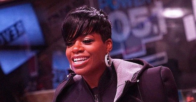 Heavily-Pregnant Fantasia Shows off Her Baby Bump in a White Leopard Mini Dress in a New Photo