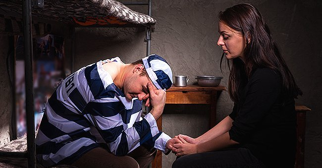 Wife visits husband in a jail | Photo: Shutterstock.com