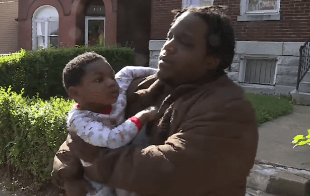 Kh'amorion Taylor and his father after he was found.   Photo: YouTube/FOX 2 St. Louis