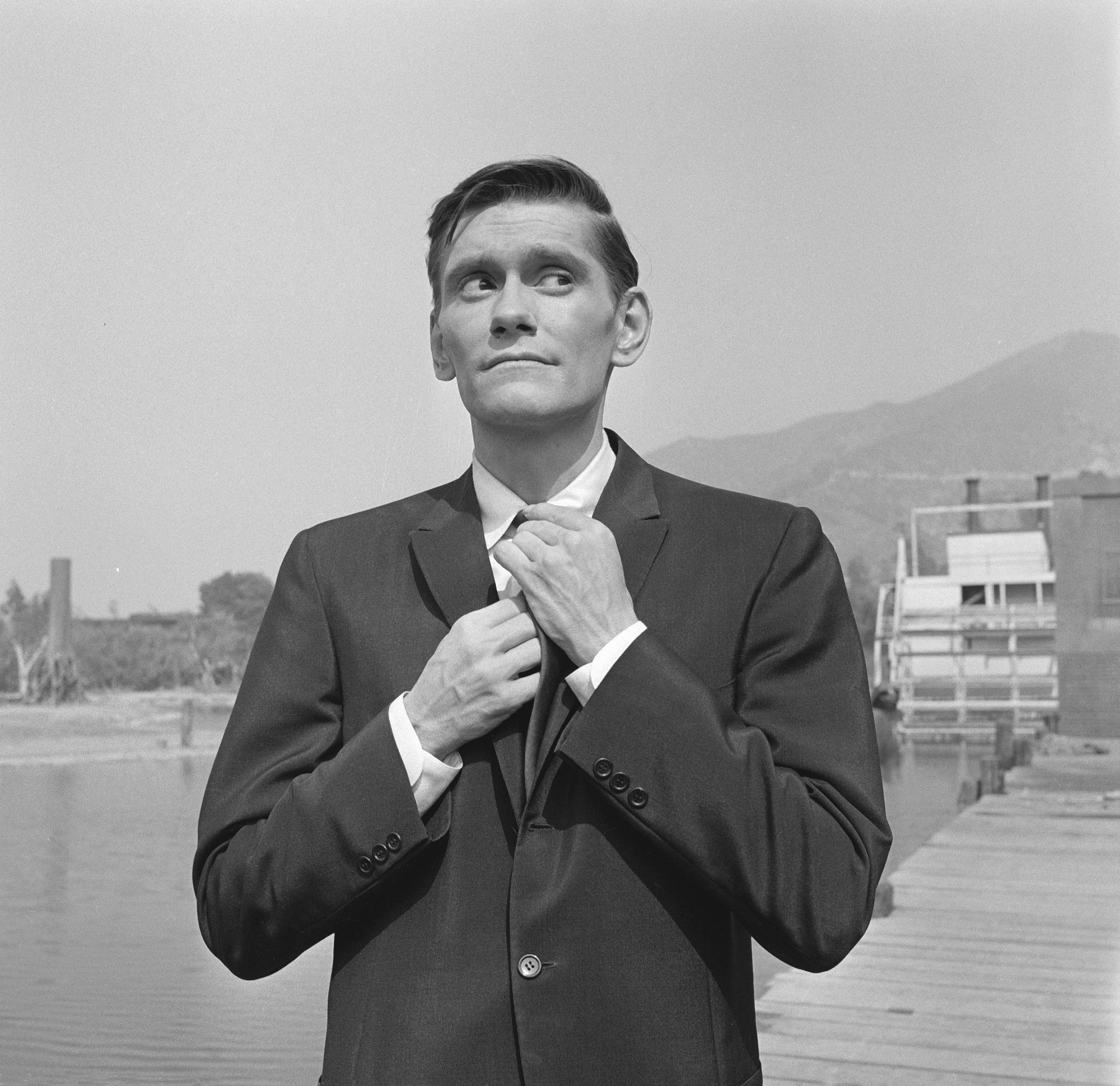 "Dick York fixes his necktie during the filming of ""The Alfred Hitchcock Presents""  on September 3, 1959. 