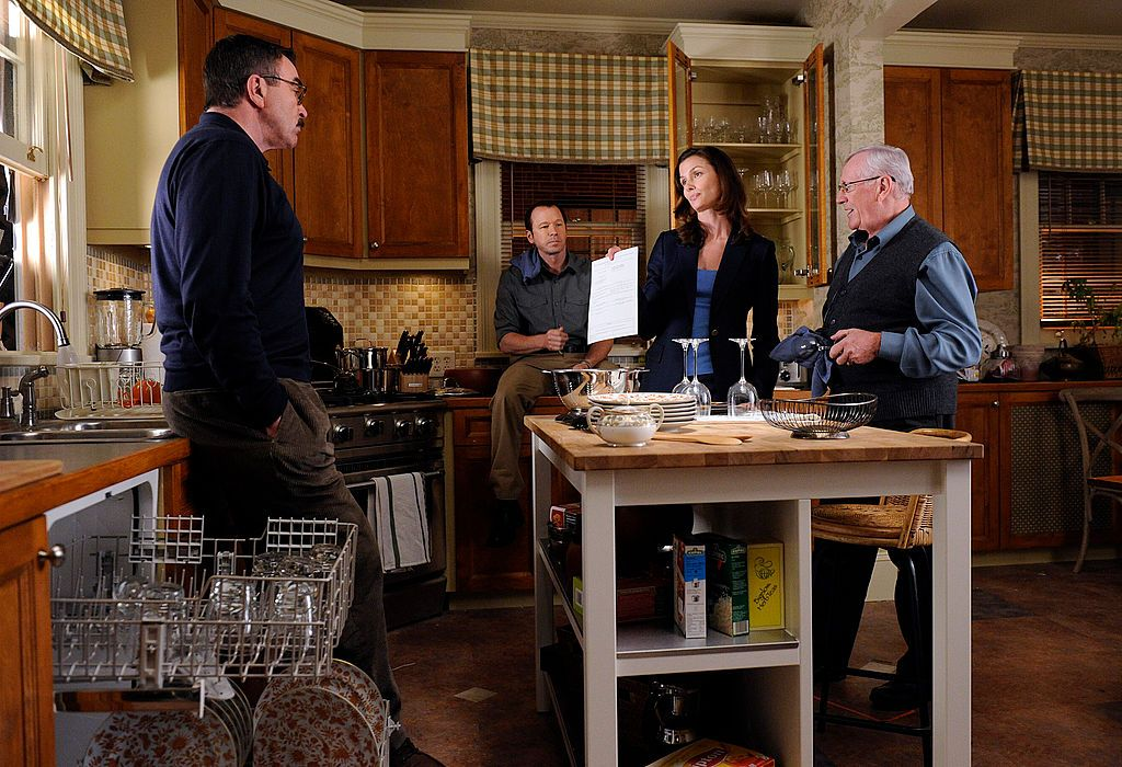"Frank (Tom Selleck), Danny (Donnie Wahlberg), Erin (Bridget Moynahan), and Henry Reagan (Len Cariou) on the set of ""Blue Bloods"" ""Privilege"" episode on September 08, 2010 