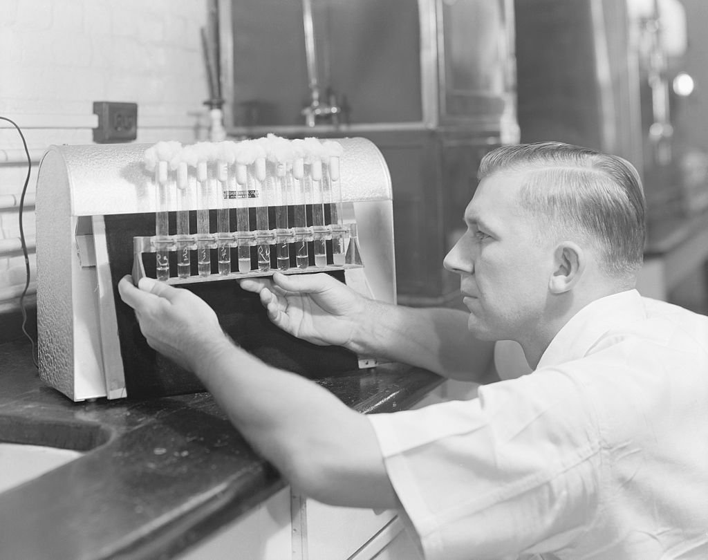Penicillin manufacturer at Charles Pfizer factory testing cultures   Source: Getty Images