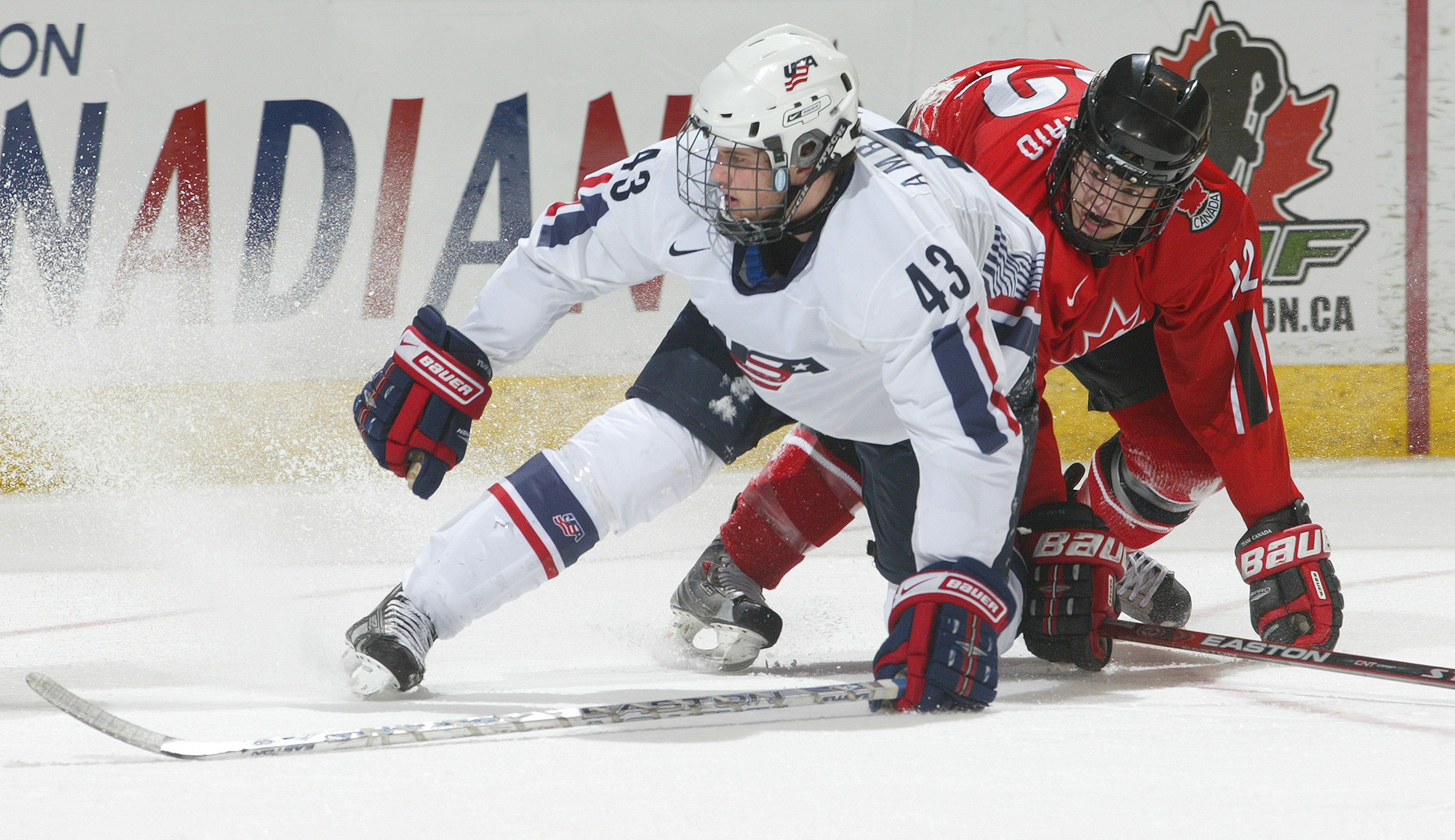Tyler Amburgey #43 of Team USA collides with Peter Holland #12 of Team Ontario in a game at the John Labatt Centre on January 4, 2008, in London, Ontario | Photo: Claus Andersen/Getty Images