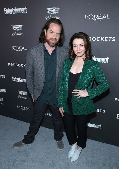 Rob Giles (L) and Caterina Scorsone attend Entertainment Weekly Celebrates Screen Actors Guild Award Nominees sponsored by L'Oreal Paris, Cadillac, And PopSockets at Chateau Marmont on January 26, 2019, in Los Angeles, California. | Source: Getty Images.