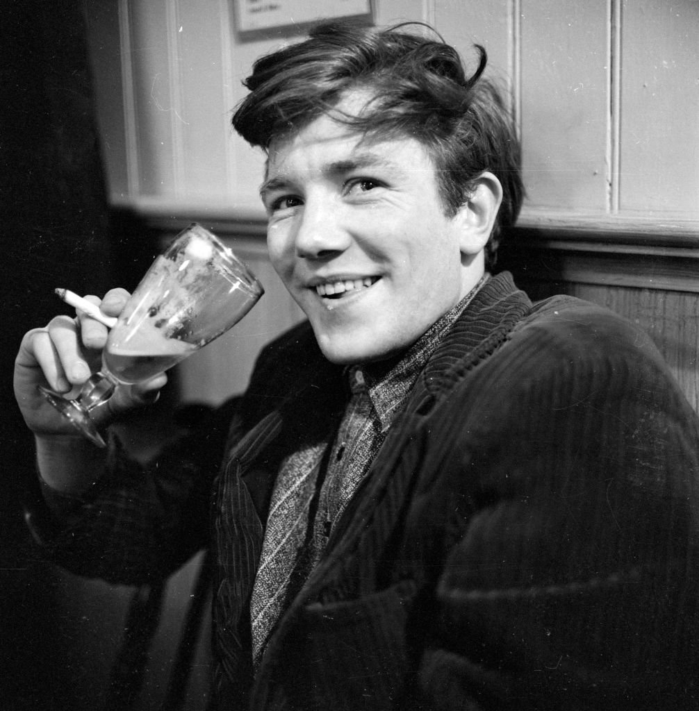British film and stage actor Albert Finney enjoying a glass of beer in his regular pub behind the Cambridge Theatre in London | Getty Images
