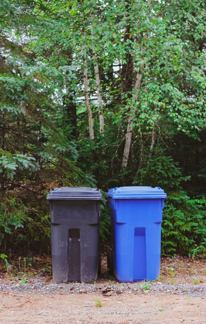 I took out the trash to the bins on the curb   Source: Unsplash