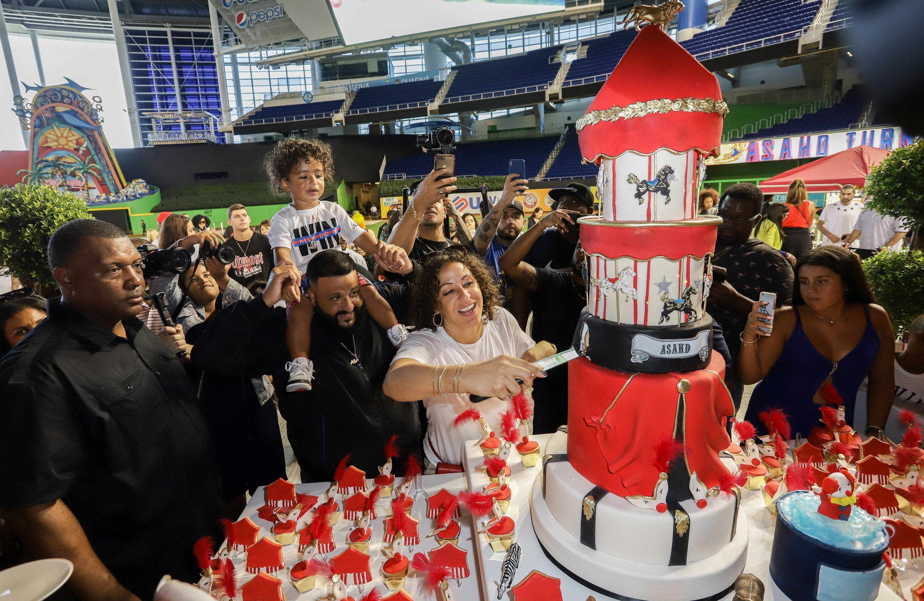 DJ Khaled went all out for his son Asahd 2nd birthday party transforming a baseball stadium into a carnival. | Photo: Getty Images