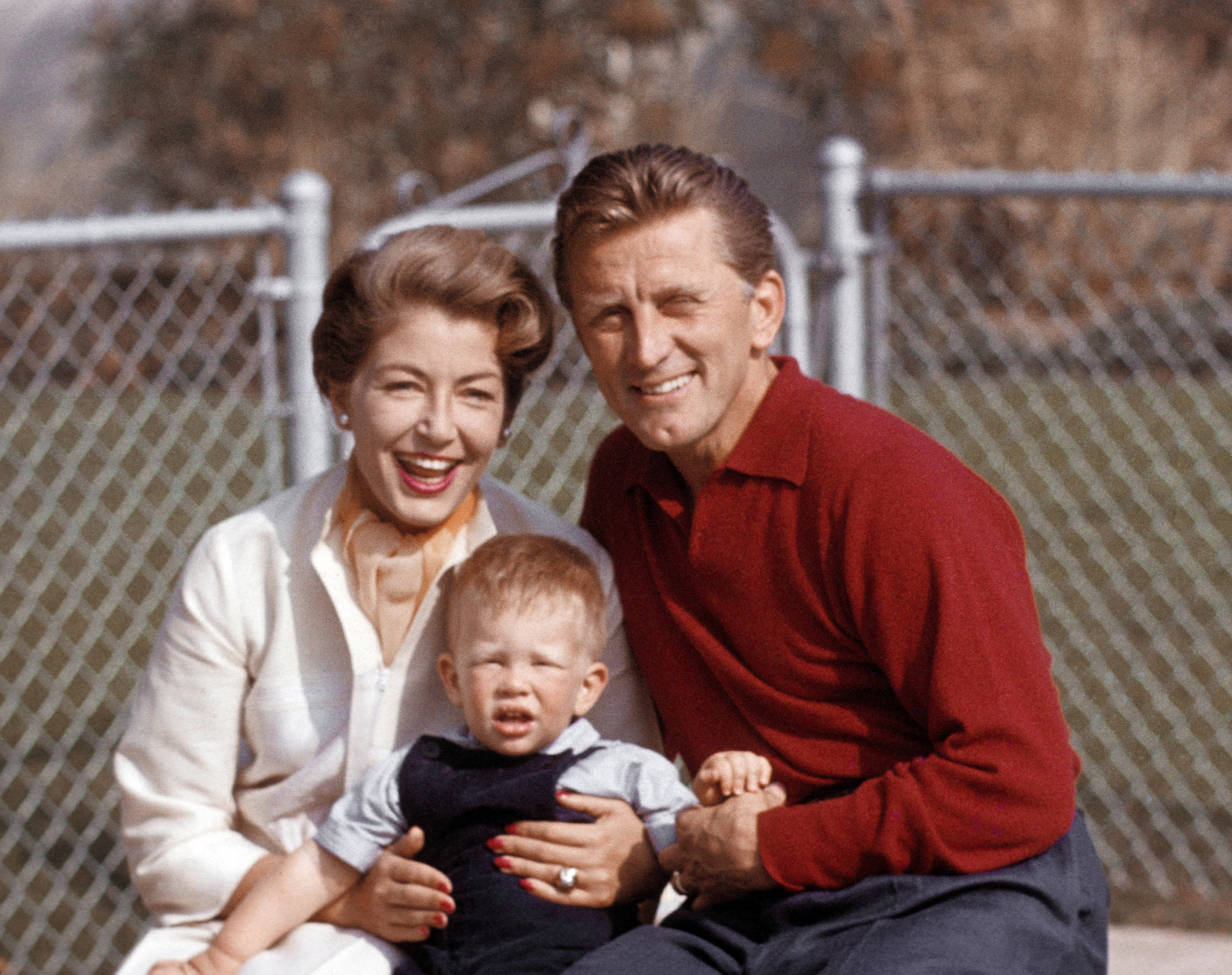 Kirk Douglas at home with his spouse Anne Douglas their son Peter Vincent Douglas on February 14, 1957 in Los Angeles | Photo: Getty Images