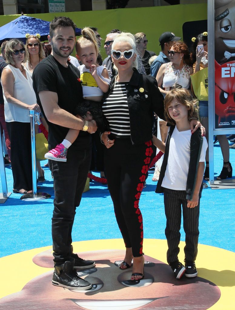 "Matthew Rutler, daughter Summer Rain Rutler, fiancée Christina Aguilera and her son Max Liron Bratman at the premiere of""The Emoji Movie"" in 2017 in Westwood, California 