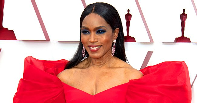 Angela Bassett Bares Cleavage at the 2021 Oscars in a Red off-Shoulder Dress with Puff Sleeves