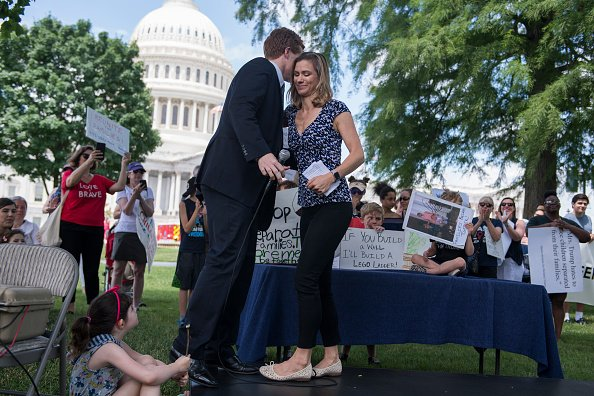 Maeve Kennedy McKean greets Rep. Joe Kennedy, D-Mass., during a rally on the East Front lawn of the Capitol to condemn the separation and detention of families at the border of the U.S. and Mexico on June 21, 2018 | Photo: Getty Images