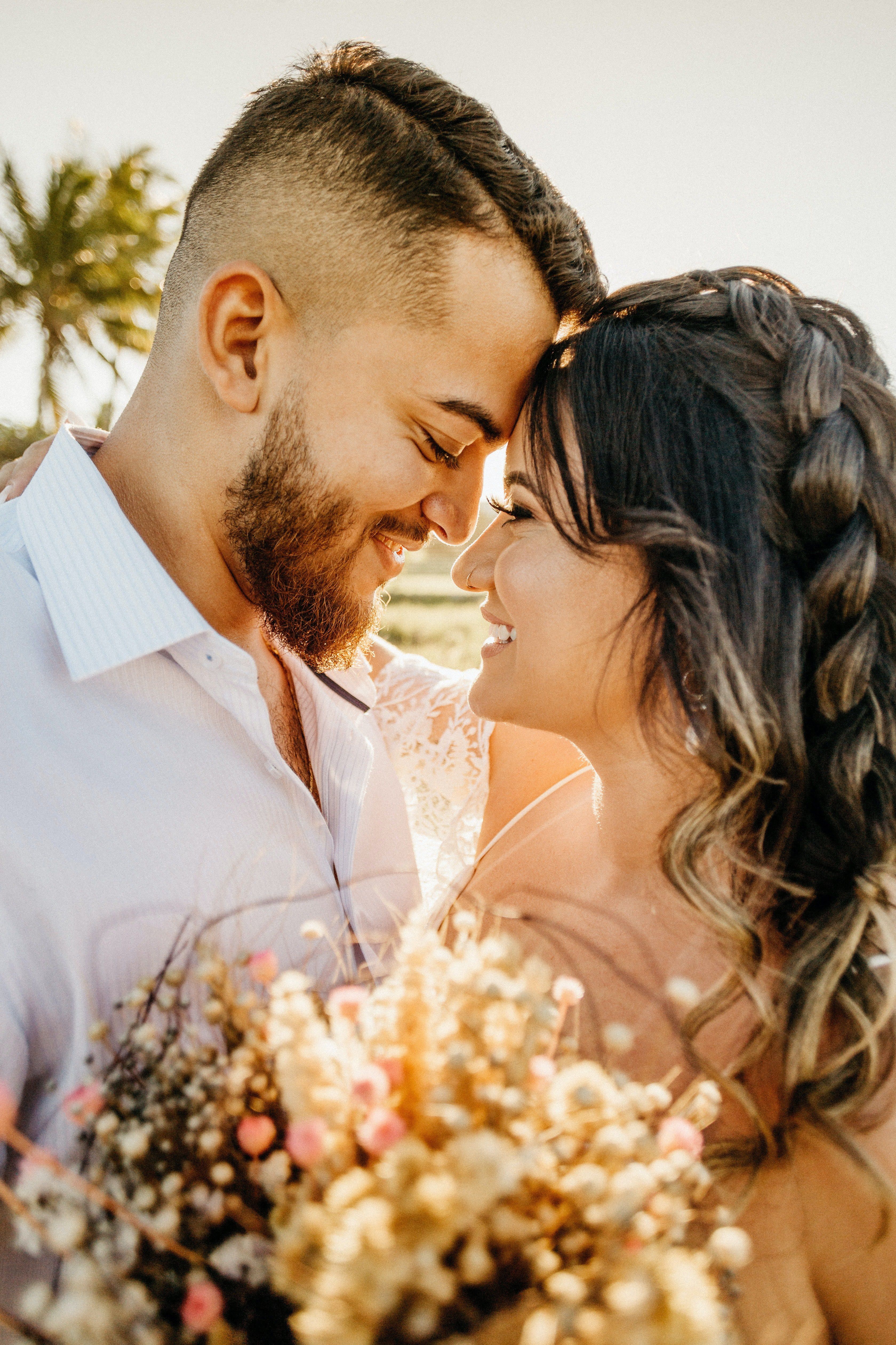 Pictured - A newly wedded couple glaring into each other's eyes while smiling and embracing each other on the beach on their wedding day. | Source: Pexels