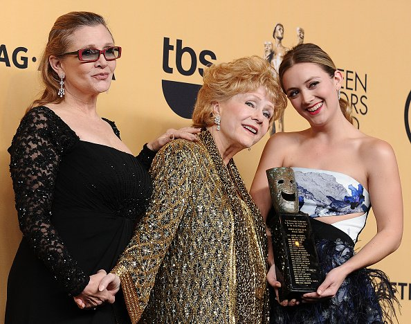 Carrie Fisher, Debbie Reynolds, and Billie Catherine Lourd at The Shrine Auditorium on January 25, 2015 in Los Angeles, California. | Photo: Getty Images