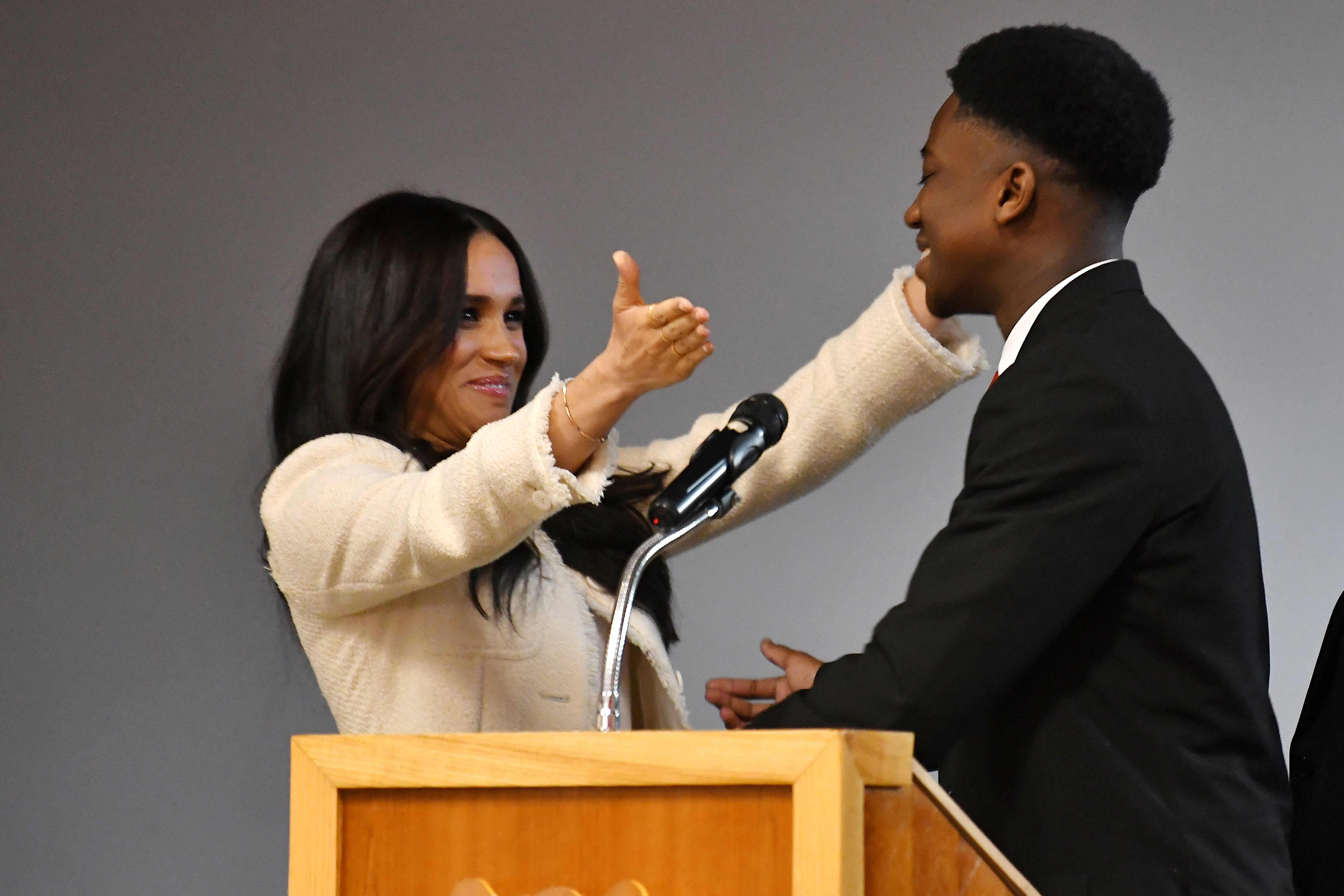 Meghan, Duchess of Sussex embraces student Aker Okoye during a special school assembly at the Robert Clack Upper School in Dagenham ahead of International Women's Day (IWD) held on Sunday 8th March, on March 6, 2020 in London, England. | Source: Getty Images