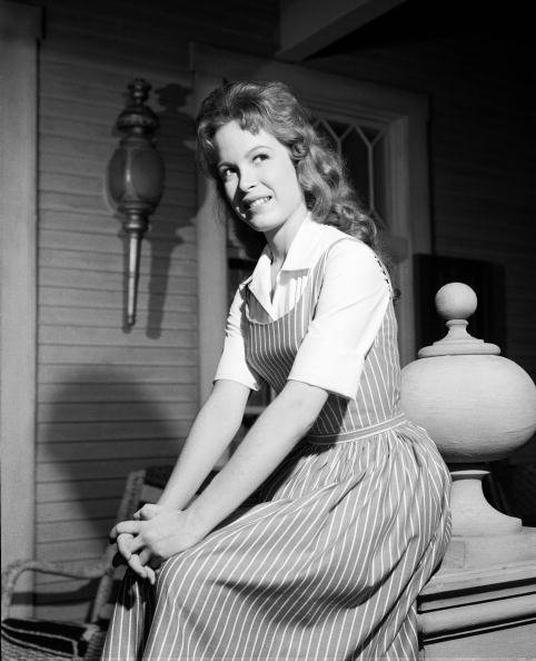 """Linda Henning sits on the porch of the Shady Rest Hotel on an episode of """"Petticoat Junction"""" in' Los Angeles, on October 2, 1963   Source: Getty Images"""