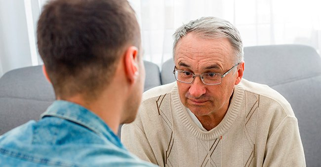 Man having a discussion with his son.   Photo: Shutterstock
