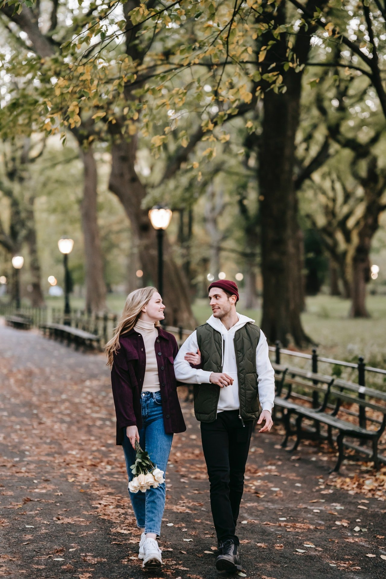 Mark and I walked hand-in-hand in the park.   Source: Pexels