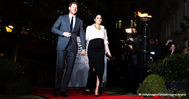 Pregnant Meghan Markle flashes legs through a deep slit, strolls hand-in-hand with Prince Harry