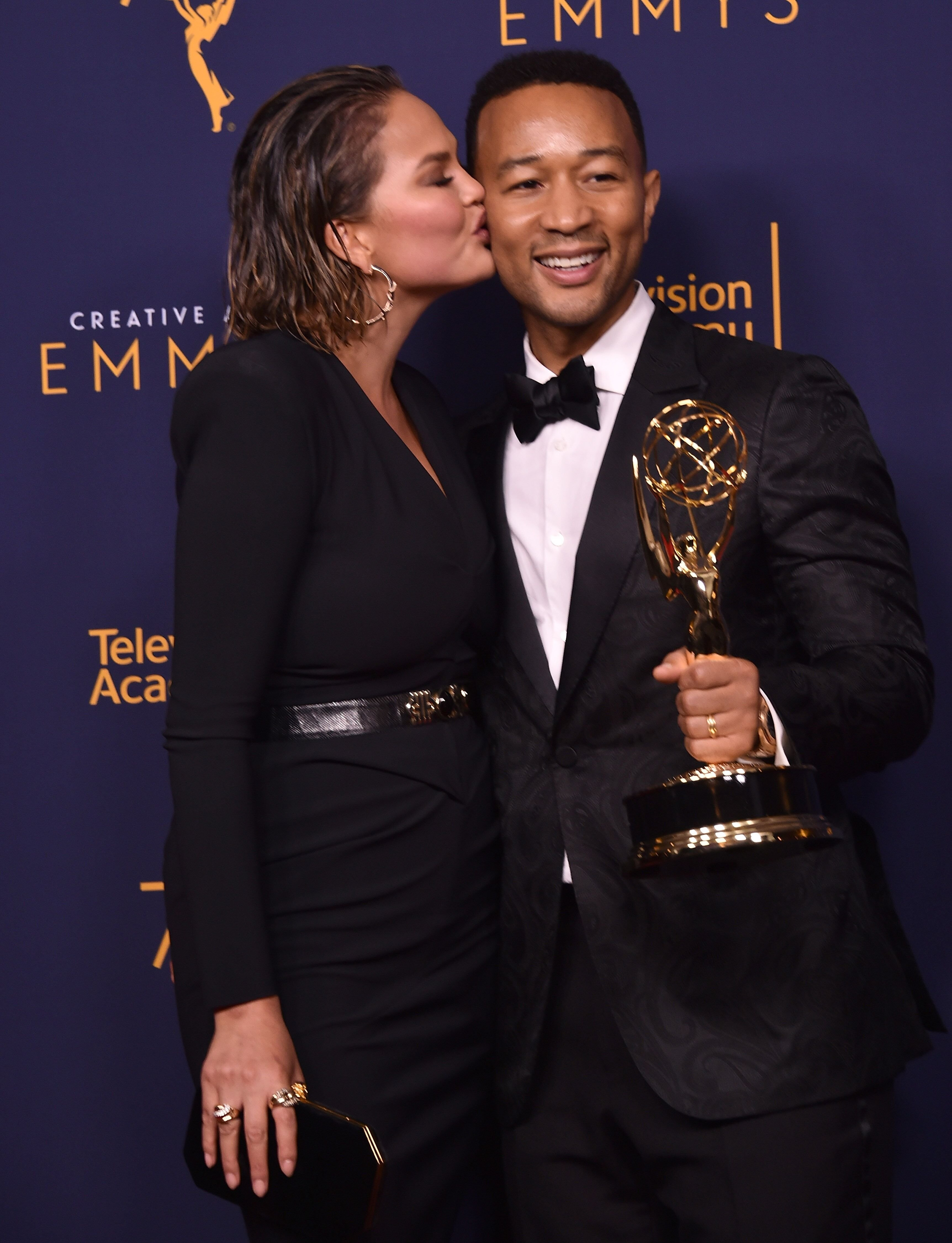 John Legend and Chrissy Teigen at the Emmys/ Source: Getty Images