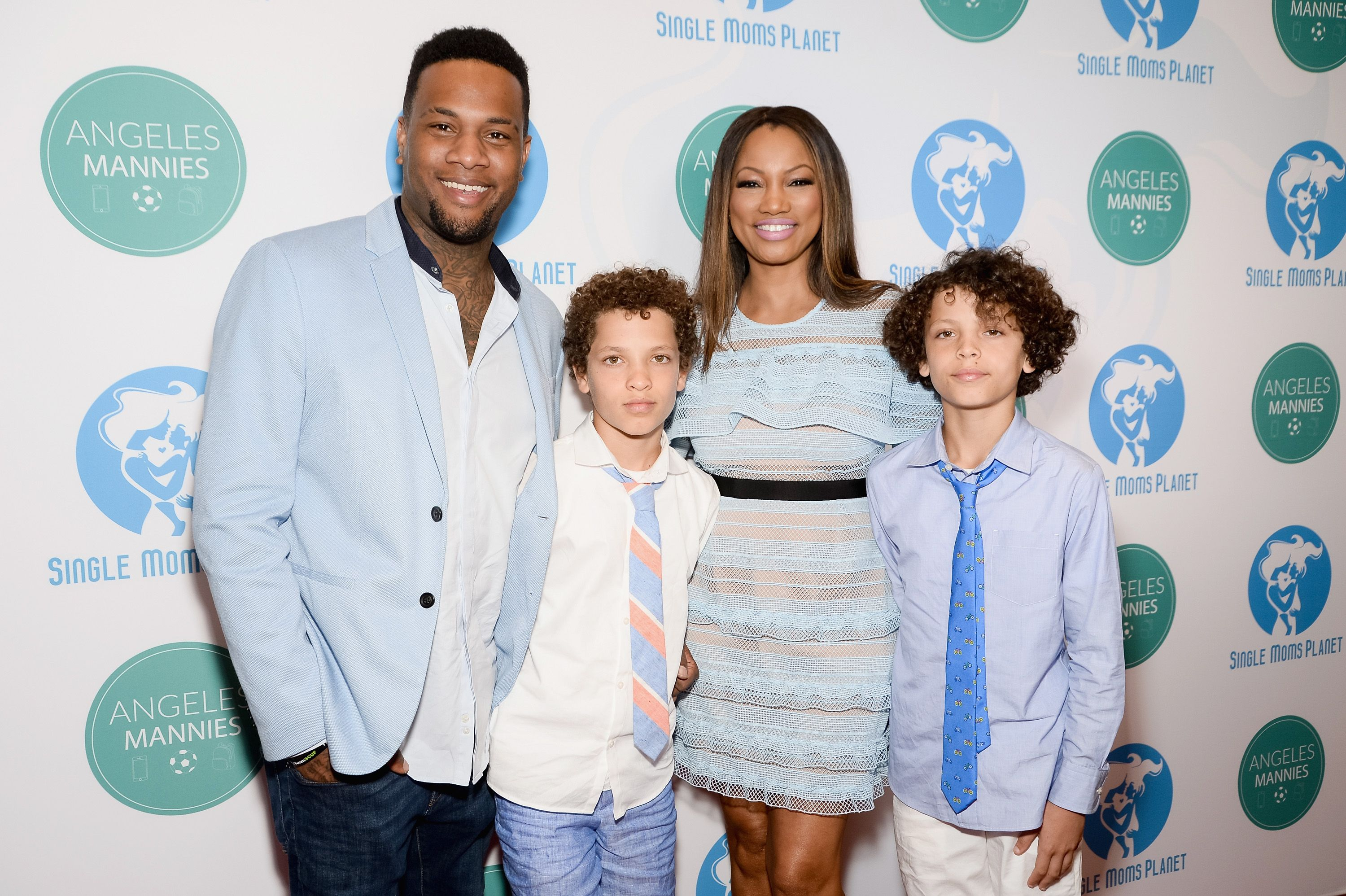 Giselle Beauvais and sons Oliver Saunders, Jaid Thomas Nilon and Jax Joseph Nilon at the Single Mom's Awards on May 11, 2017 in Beverly Hills. | Photo: Getty Images