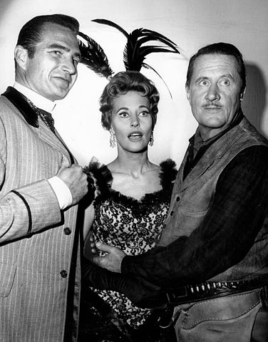 Eric Fleming as Gil Favor and guest stars Lola Albright and Allyn Joslyn from the television program Rawhide in 1964. | Source: Wikimedia Commons.