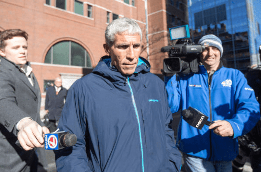 """William """"Rick"""" Singer is swarmed by press as her leaves Boston Federal Court after being charged for his role in the college admissions scandal on March 12, 2019 in Boston, Massachusetts 
