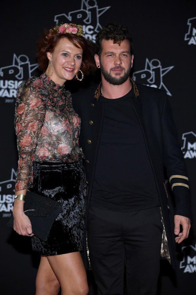 Claudio Capéo et sa femme assistent aux 20èmes NRJ Music Awards à Cannes. | Getty Images