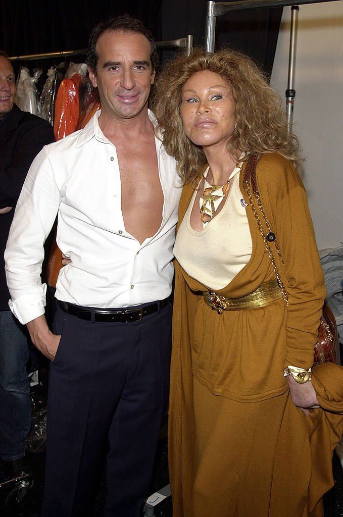 Lloyd Klein and Jocelyne Wildenstein during Mercedes-Benz Fashion Week Spring 2004 - Lloyd Klein - Front Row and Backstage at Josephine Tent, Bryant Park in New York City, New York, United States. | Source: Getty Images