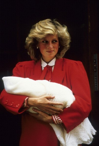 Princess Diana carries newborn Prince Harry as she and Prince Charles leave the hospital on September 16, 1984, a day after Harry was born.   Source: Getty