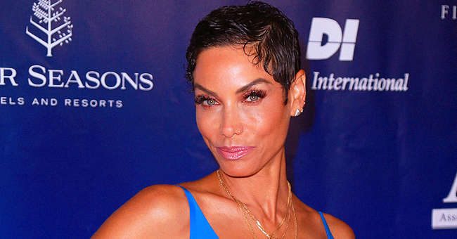 Nicole Murphy Shares Adorable Photo of Her Granddaughter Evie in Patterned Outfit and a Pink Cap