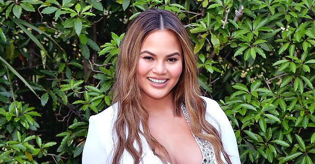 Chrissy Teigen from 'Chrissy's Court' Shares Hot Swimsuit Snap with Her New Dog Petey