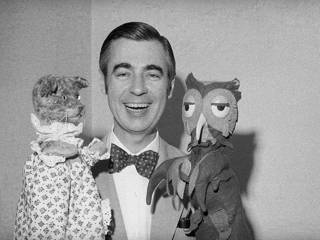 "Fred Rogers of Mister Rogers' Neighborhood holds Henrietta Pussycat (left) and ""X"" the Owl during an interview.  
